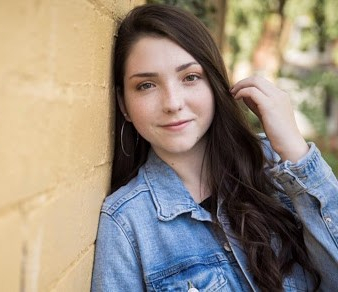 Photo of Kaitlyn Meyers, young adult, white woman with long brown hair